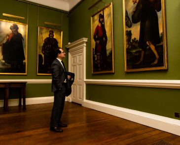 mage of Dr Ignacio Cartagena Núñez, Spain's Consul General in Edinburgh, looking at Zurbarán's paintings of Jacob and His Twelve Sons in the Long Dining Room at Auckland Castle.